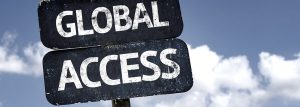 "Photograph of a weathered sign with the text ""Global Access"""
